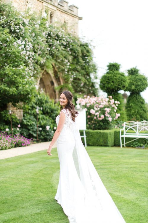 Bride in Lace Wedding Dress and Bridal Cape