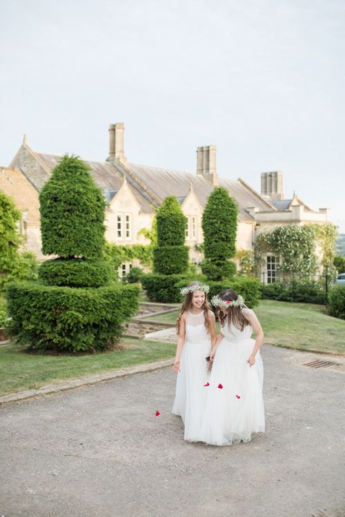 Young Bridesmaids in White Tulle Dresses and Gypsophila Flower Crowns