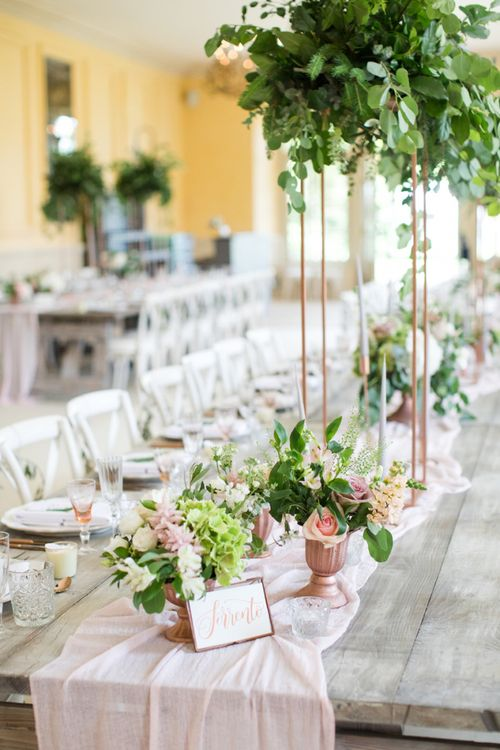 Long Tables with Pink Table Runner and Tall Copper Floral Displays