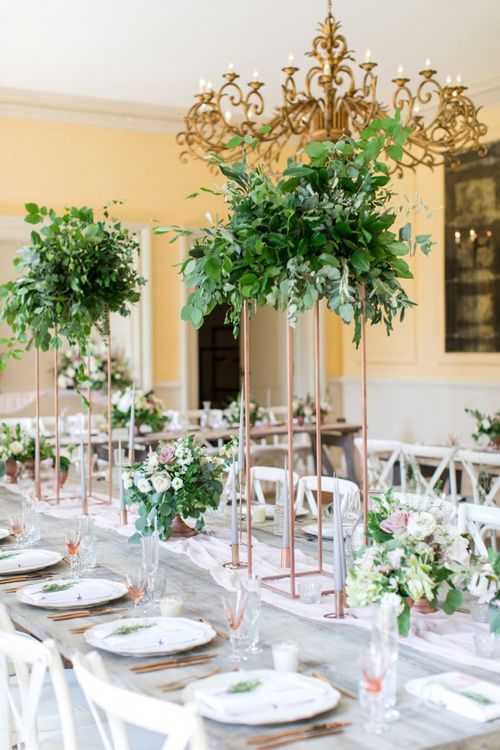 Tall Copper Pipe Centrepieces with Foliage