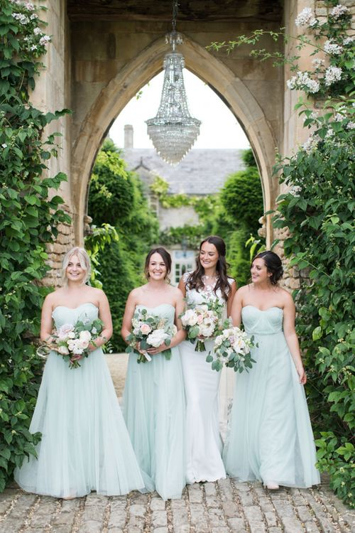 Bridal Party Portrait with Bridesmaids in Pale Green Dresses