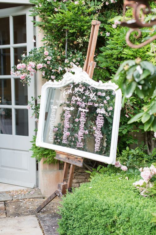 White Ornate Glass Table Plan on an Easel