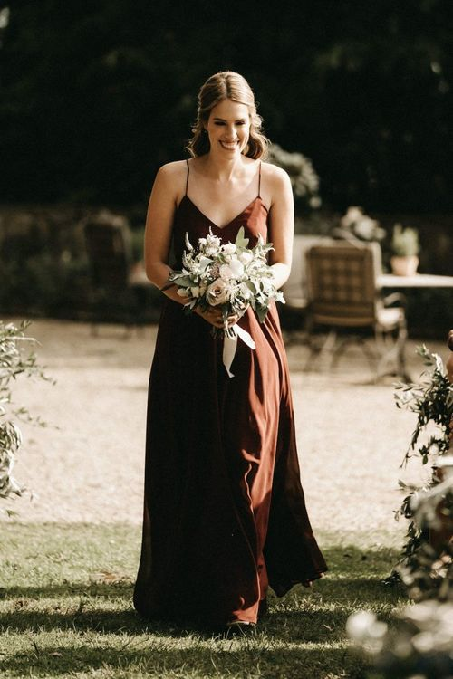 Bridesmaid walks down the aisle at Villa Le Fontanelle wedding