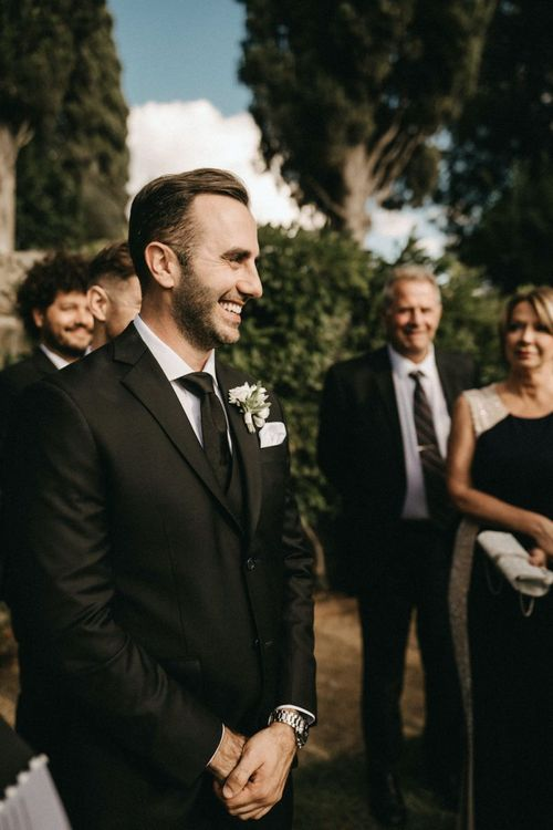 Groom waits for bride at ceremony at Villa Le Fontanelle