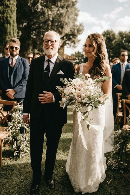 Bride clutches blush bouquet at Florence wedding at Villa Le Fontanelle