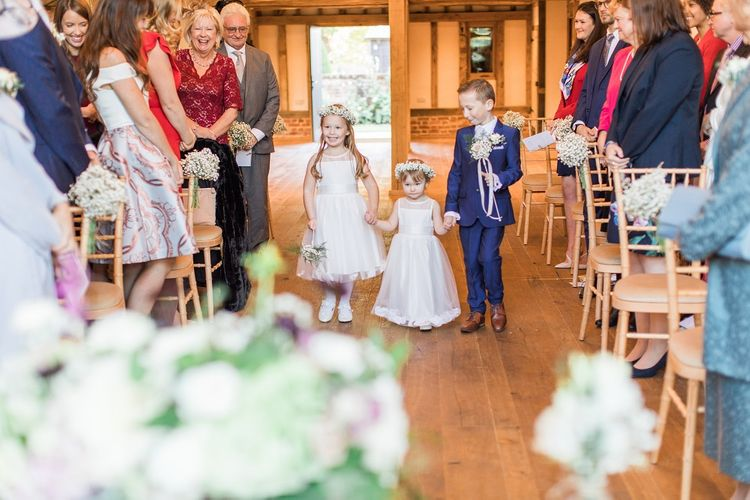 Flower Girls and Page Boy Walking Down the Aisle