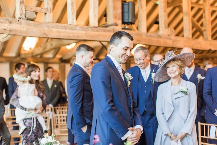 Groom in Navy Three-Piece Suit Waiting at the Altar