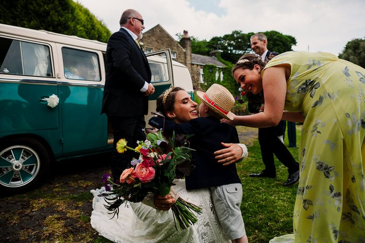 Bride Hugging Page Boy | DIY Tipi Wedding in Yorkshire | Tim Dunk Photography