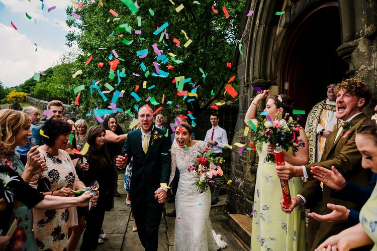 Confetti Exit | Bride Made Her Own Bespoke Gown - Kindling Bridal | Groom in Wool Beggars Run Suit | DIY Tipi Wedding in Yorkshire | Tim Dunk Photography