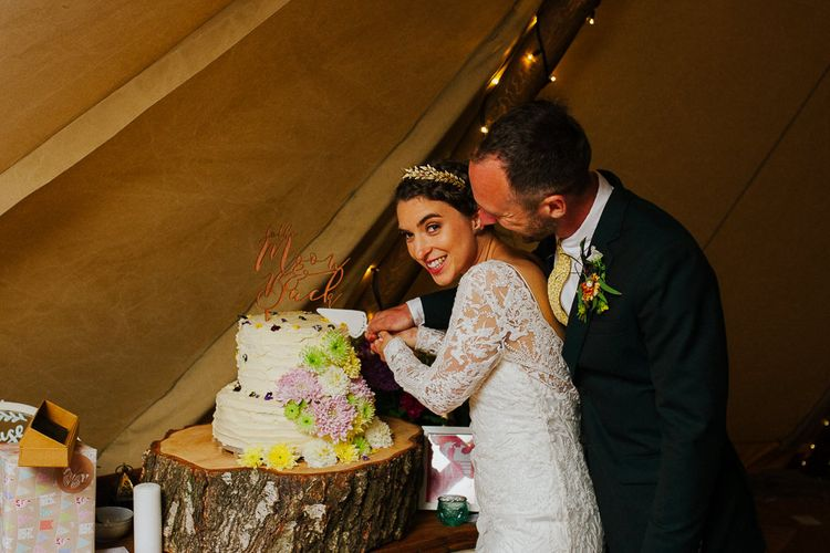 Bride & Groom Cutting the Cake | DIY Tipi Wedding in Yorkshire | Tim Dunk Photography
