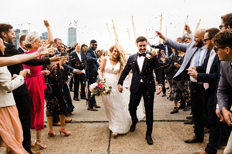 Confetti Exit | Bride in Ted Baker Wedding Dress | Groom in Tuxedo | The Electricians Shed, Trinity Buoy Wharf Wedding Planned by Utterly Wow | Claudia Rose Photography