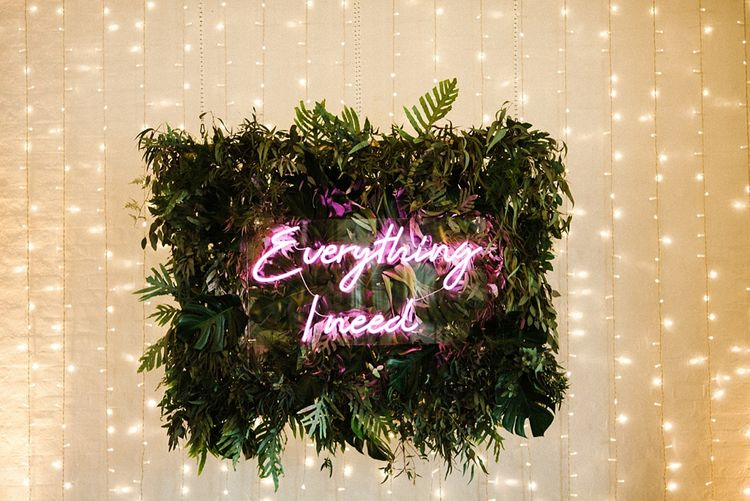Neon Light Sign with Greenery Garland Frame | The Electricians Shed, Trinity Buoy Wharf Wedding Planned by Utterly Wow | Claudia Rose Photography