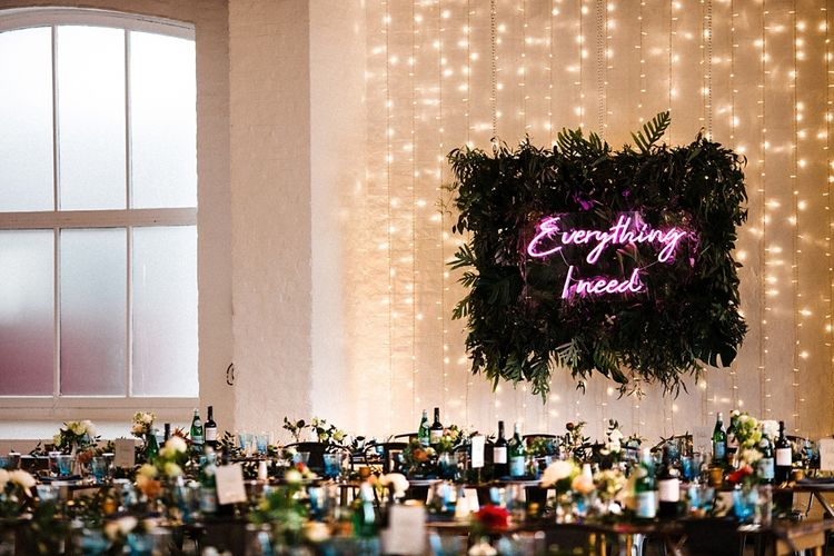 Industrial Wedding Decor | Neon Sign Top Table Backdrop | The Electricians Shed, Trinity Buoy Wharf Wedding Planned by Utterly Wow | Claudia Rose Photography