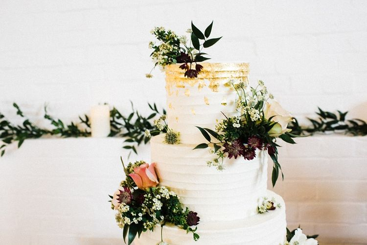 Frosted Wedding Cake with Floral Decor | The Electricians Shed, Trinity Buoy Wharf Wedding Planned by Utterly Wow | Claudia Rose Photography
