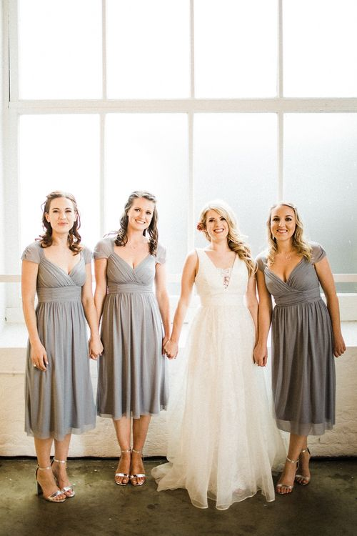 Grey ASOS Bridesmaid Dresses | Bride in Ted Baker Tie The Knot Wedding Dress | The Electricians Shed, Trinity Buoy Wharf Wedding Planned by Utterly Wow | Claudia Rose Photography