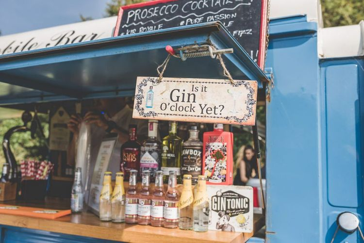 Drinks truck with gin selection at village fete themed outdoor wedding reception