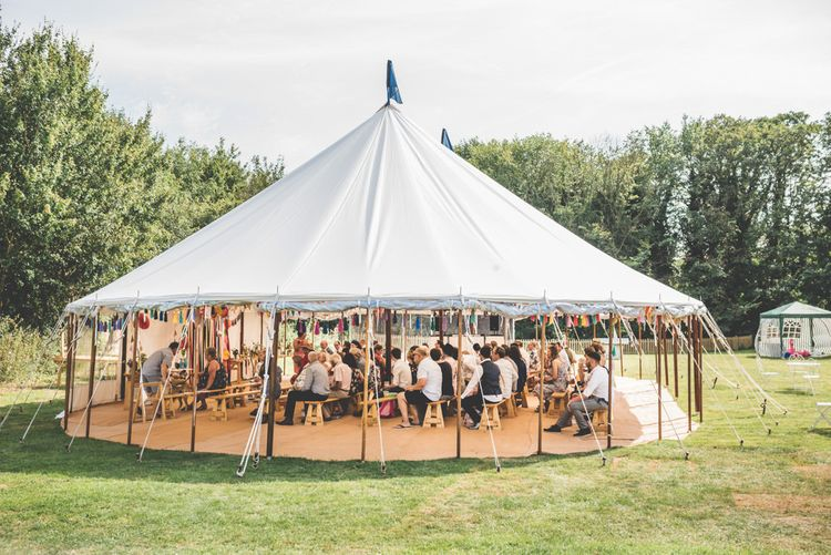 Village fete festival styled marquee reception with bunting and ribbon decoration