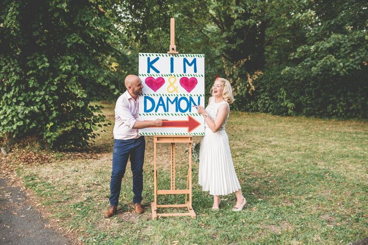 Personalised easel style wedding sign with pleated midi wedding skirt