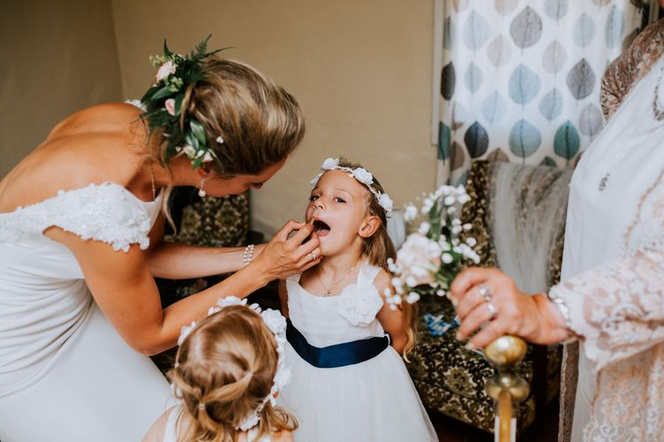 Flower Girls In White Dresses With Navy Sashes / Image By Sally Rawlins Photography