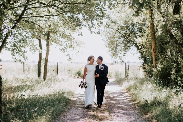 DIY Wedding At Thurston's Farm Suffolk With Bride In Pronovias And Bridesmaids In Navy Dresses From Monsoon With Images From Sally Rawlins Photography