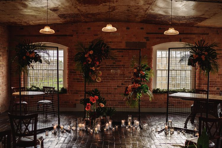 Altar Wedding Decor with Candles, Tropical Plants and Wire Screens