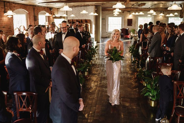 Bridesmaid in Gold Sequin Dress Walking Down The Aisle