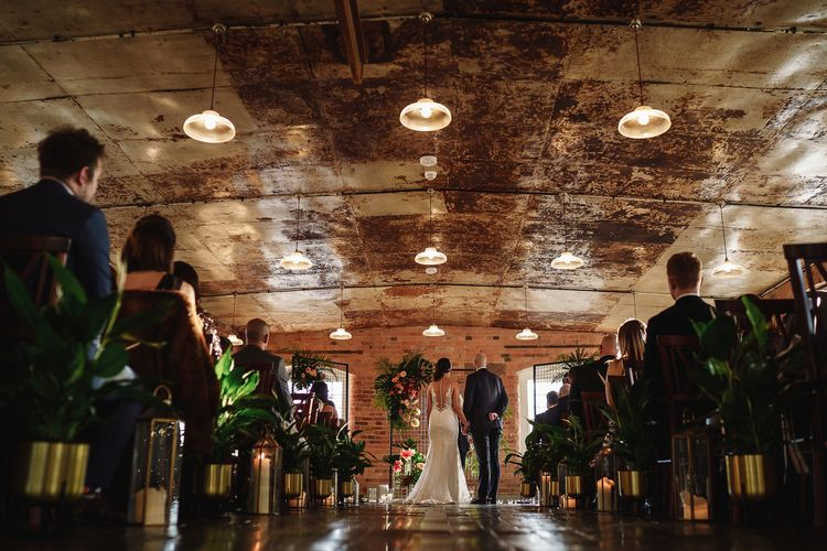 Bride and Groom Standing at The Altar in The West Mill Wedding Venue