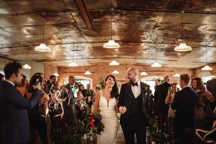 Bride in Martina Liana Lace Wedding Dress and Groom in Tom Ford Suit Walking up The West Mill Wedding Venue Aisle