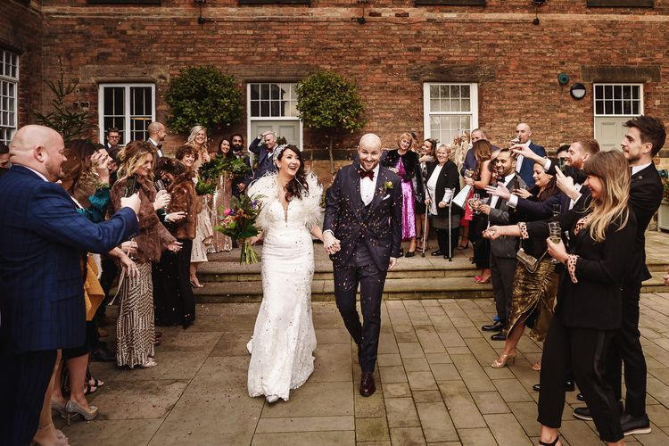 Confetti Moment with Bride in Martina Liana Wedding Dress & Ostrich Feather Cover-up and  Groom in Tom Ford Suit