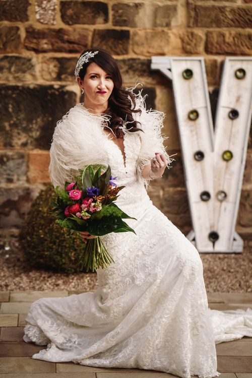 Bride in Martina Liana Wedding Dress & Ostrich Feather Cover-up