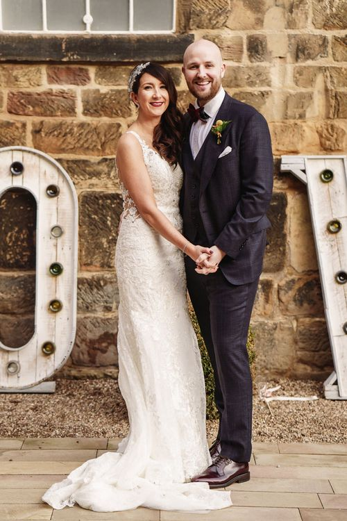 Bride in Lace Martina Liana Wedding Dress & Groom in Tom Ford Suit