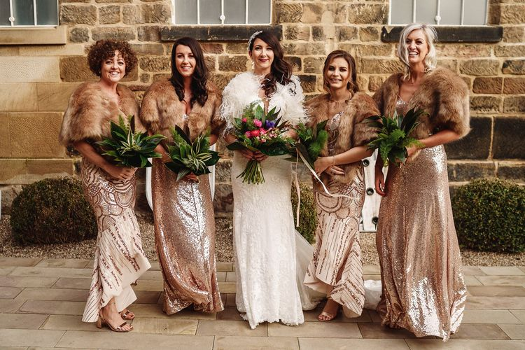 Bridal Party with Bridesmaids in Gold Sequin Dresses and Faux Fur Cover Ups and Bride in Martina Liana Wedding Dress & Ostrich Feather Cover-up