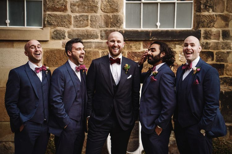 Groom in Tom Ford Suit and Bow Tie and Groomsmen in Navy Suits