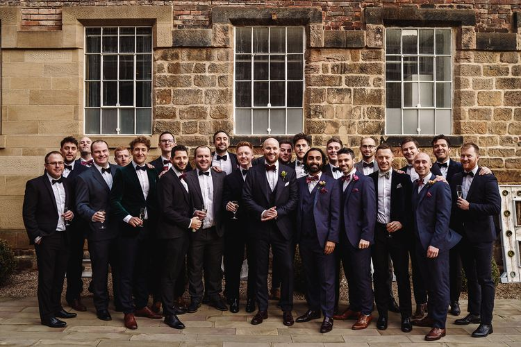 Groom in Tom Ford Suit and Bow Tie and Male Friends in Black Tie Suits