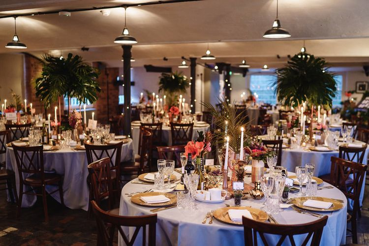 Tropical Wedding Reception Table Decor with Gold Platters and Foliage Centrepieces