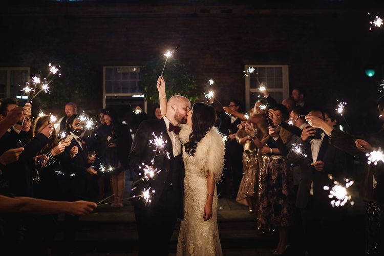 Sparkler Moment with Bride in Martina Liana Wedding Dress & Ostrich Feather Cover-up and Groom in Tom Ford Suit