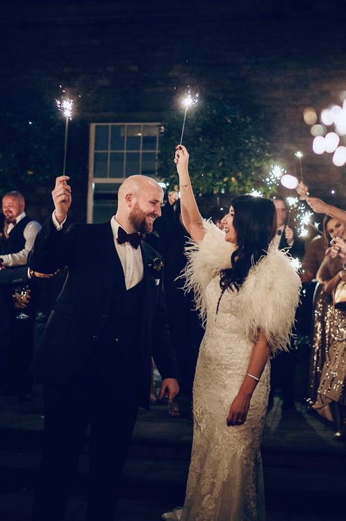 Sparkler Exit with Bride in Martina Liana Wedding Dress & Ostrich Feather Cover-up and Groom in Tom Ford Suit