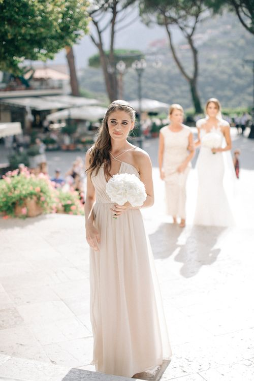 Bridesmaid in Nude Halterneck Dress with White Hydrangea Bouquet | Three Day Ravello Wedding at Villa Cimbrone on Amalfi Coast Italy |  M & J Photography | Marco Caputo Films
