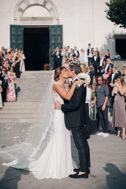 Confetti Exit | Bride in Lace Illusion Neckline Wedding Dress | Groom in Black Tie Gieves & Hawkes Suit | Three Day Ravello Wedding at Villa Cimbrone on Amalfi Coast Italy |  M & J Photography | Marco Caputo Films