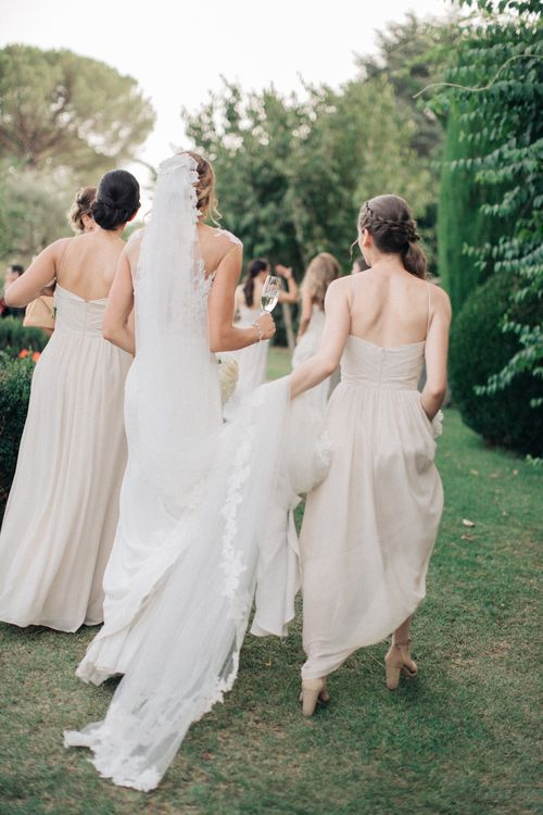 Bride in Lace Illusion Neckline Wedding Dress | Bridesmaids in Nude Halterneck Dresses | Three Day Ravello Wedding at Villa Cimbrone on Amalfi Coast Italy |  M & J Photography | Marco Caputo Films