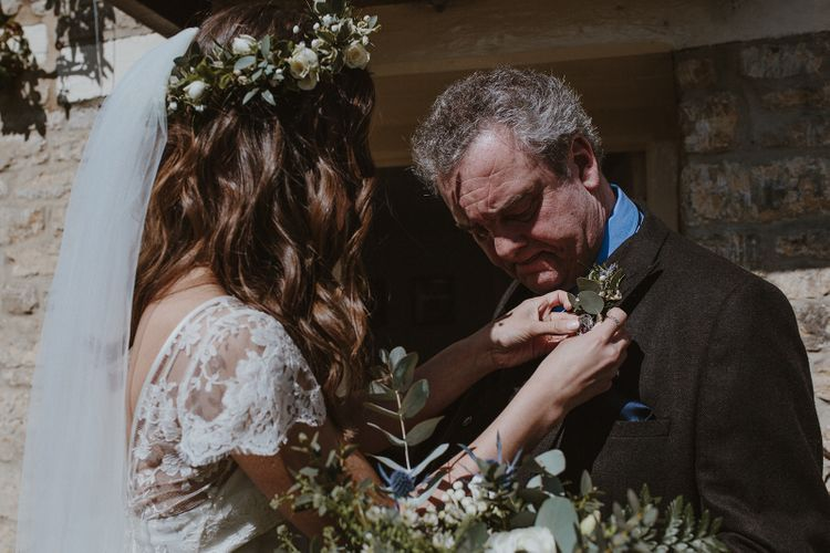 Bride with Flower Crown putting on Father's Buttonhole