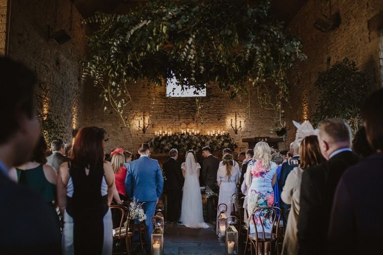 Bride and Groom at The Altar During Their Wedding Ceremony at Cripps Barn