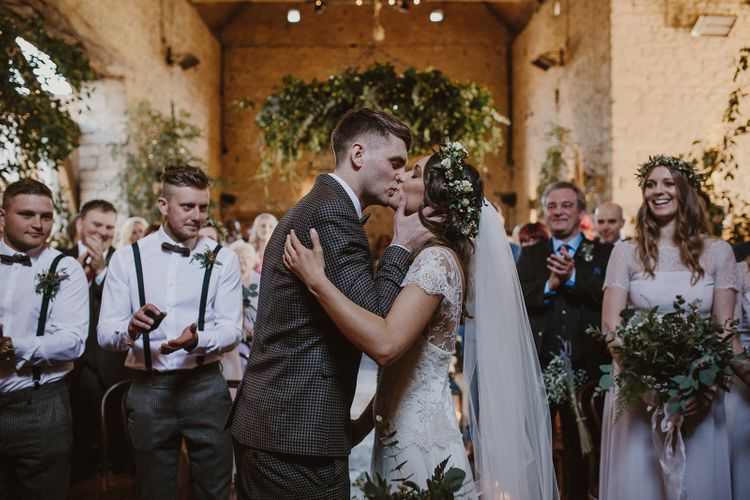 Bride and Groom Kissing After Just Being Announced Husband and Wife