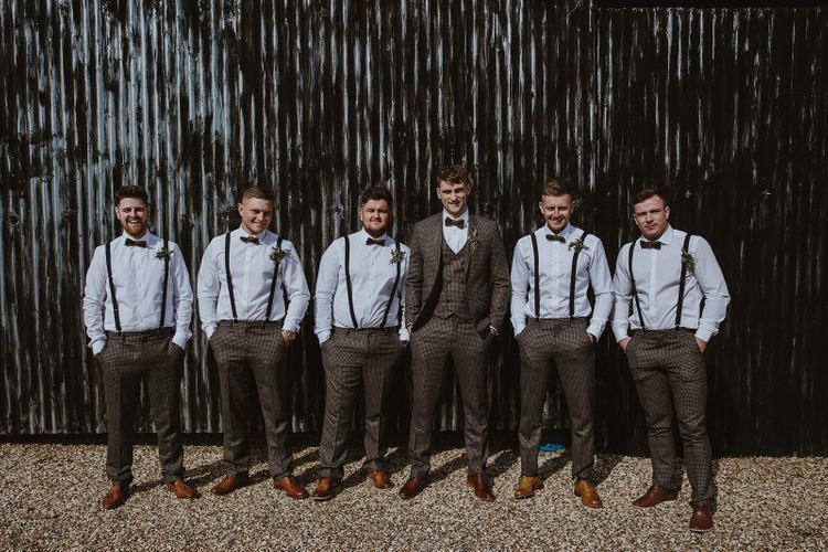Groom in Brown Check Suit and Groomsmen in Braces and Bow Ties