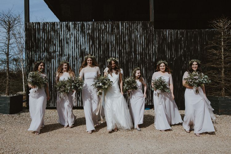 Bridal Party Walking with Their Big Greenery Bouquets