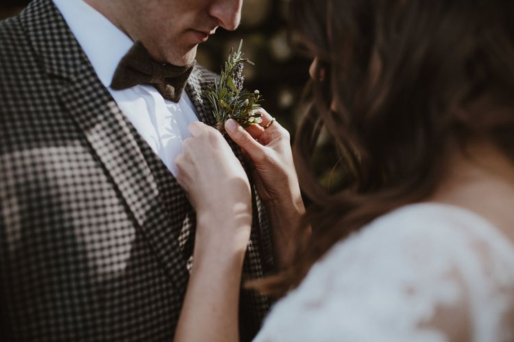 Bride Adjusting the Grooms Buttonhole
