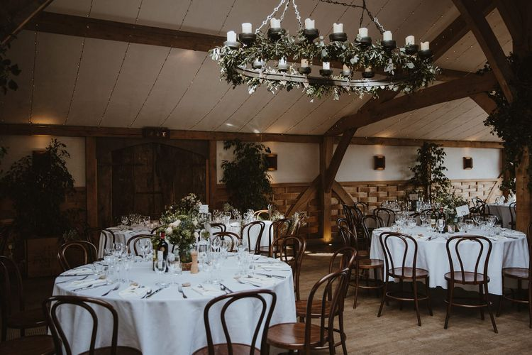 Cripps Barn Wedding Reception Decor with Hanging Chandelier and  Greenery Decor