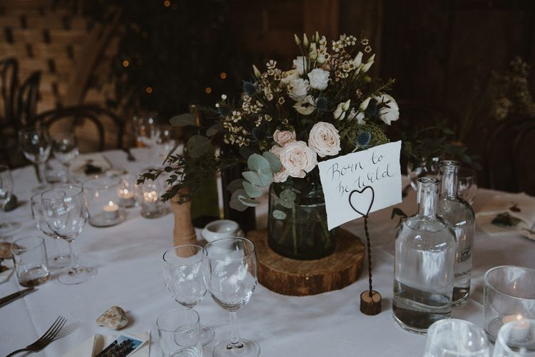 Rustic Table Centrepiece with Log Slice and Flowers in a Jar