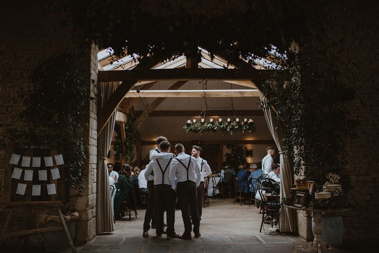 Entrance to Wedding Reception with Groomsmen in Braces Standing Arm in Arm