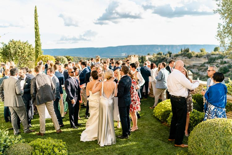 Wedding Guests | Luxe Pink & White Destination Wedding at La Bastide de Gordes in Provence, France, Styled by Haute Wedding | John Barwood Photography | Motion Craft Creative